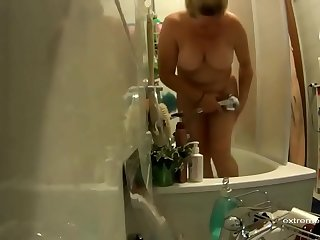 peeking at stepmom with my cock in my hand