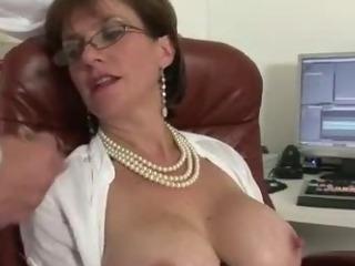 Mature stocking slut handjob and cumshot