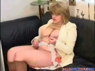 Busty mature in pantyhose jerking guy off